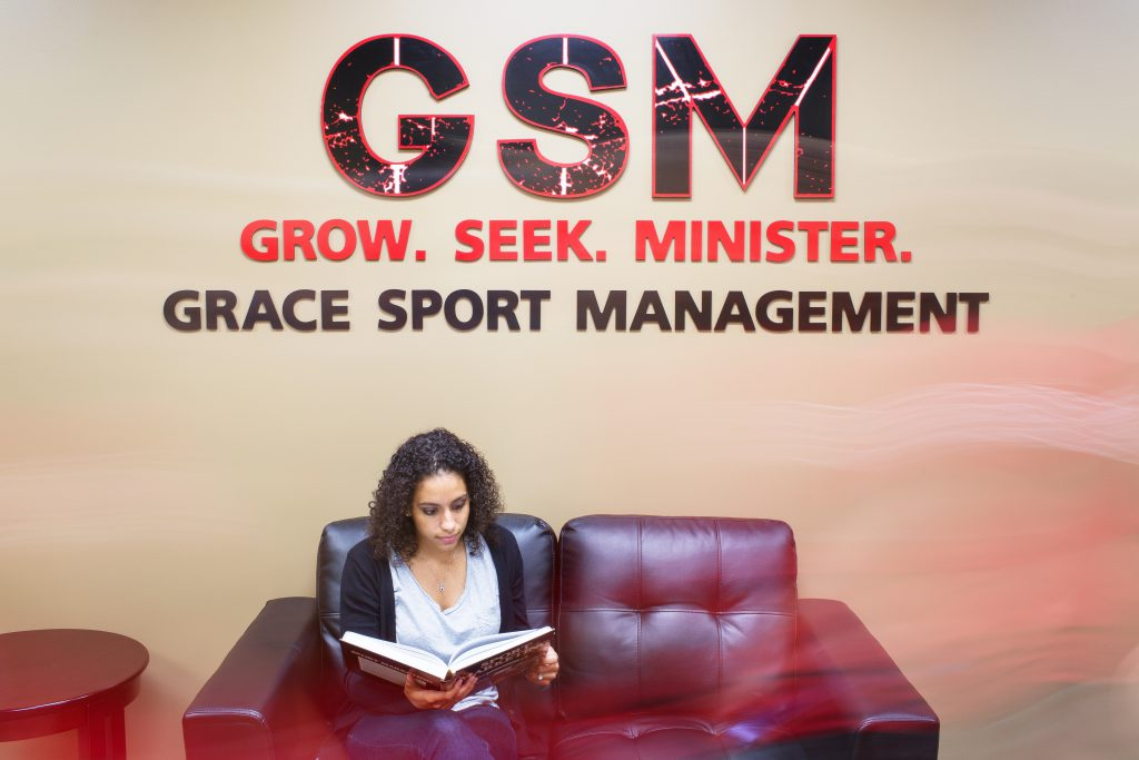 Student with Grace sport management sign