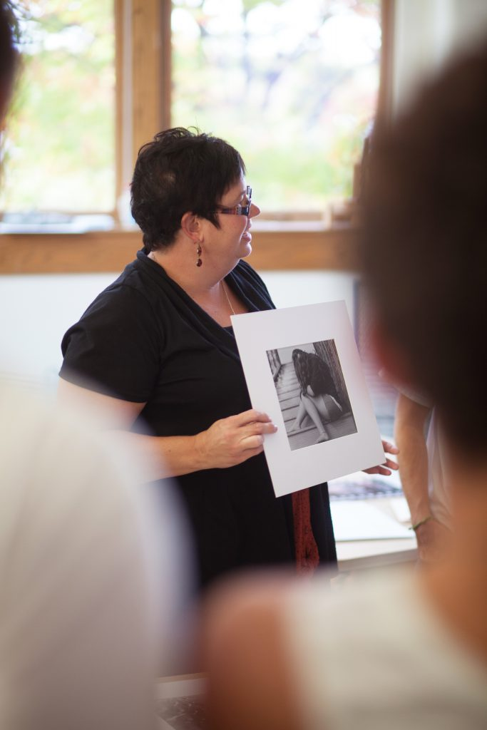 Professor Croy showing students photography