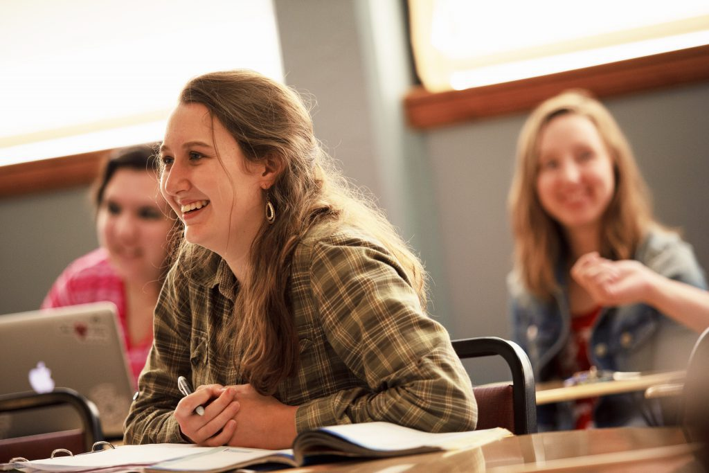 student in class smiling