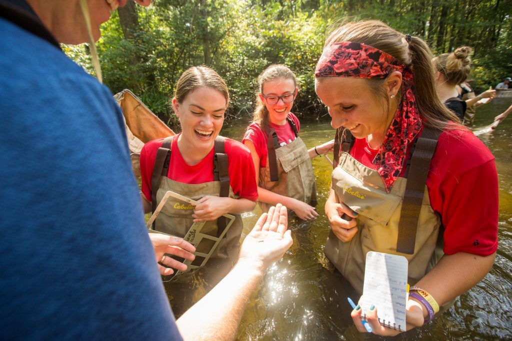 Life Science Education Major students with Dr. Bosch in stream collecting data