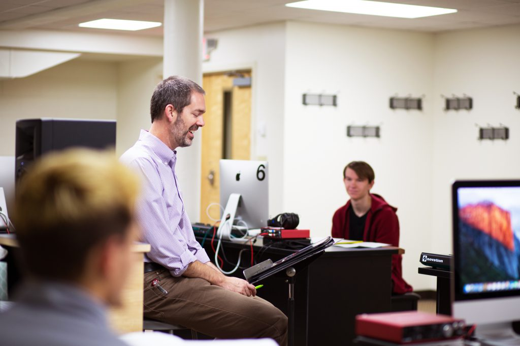 Students in class with professor teaching