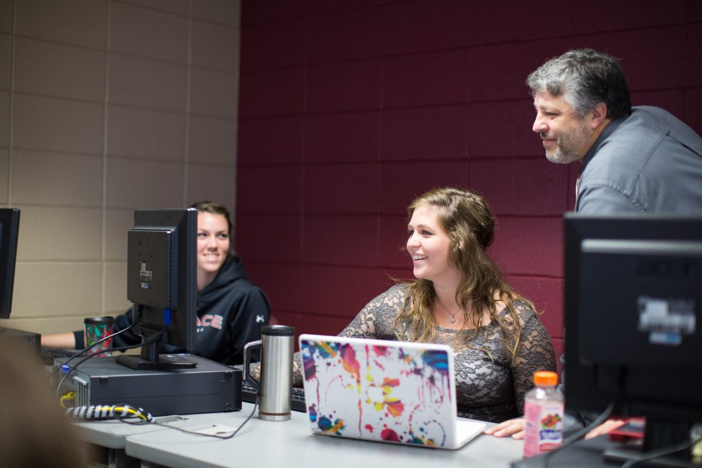 Students in computer lab with professor of Information Systems Major