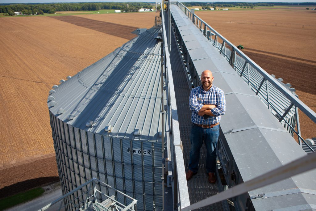 Professor of Agribusiness class on top of the silos