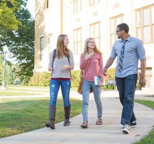 Students walking and talking across campus