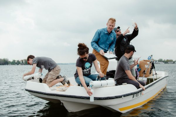 The Lilly Lakes and Streams team works in a boat.