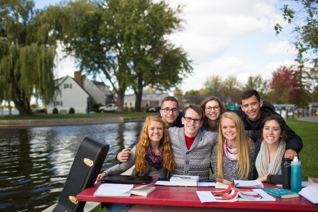 Students at the lake at a picnic table